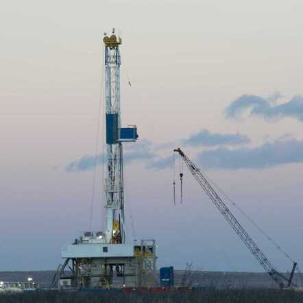Drilling Rig in the Evening in the Basin