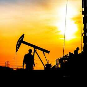 Oil Pump and Worker in Permian Basin